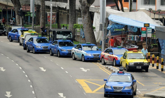 Taxis queuing up at a taxi stand
