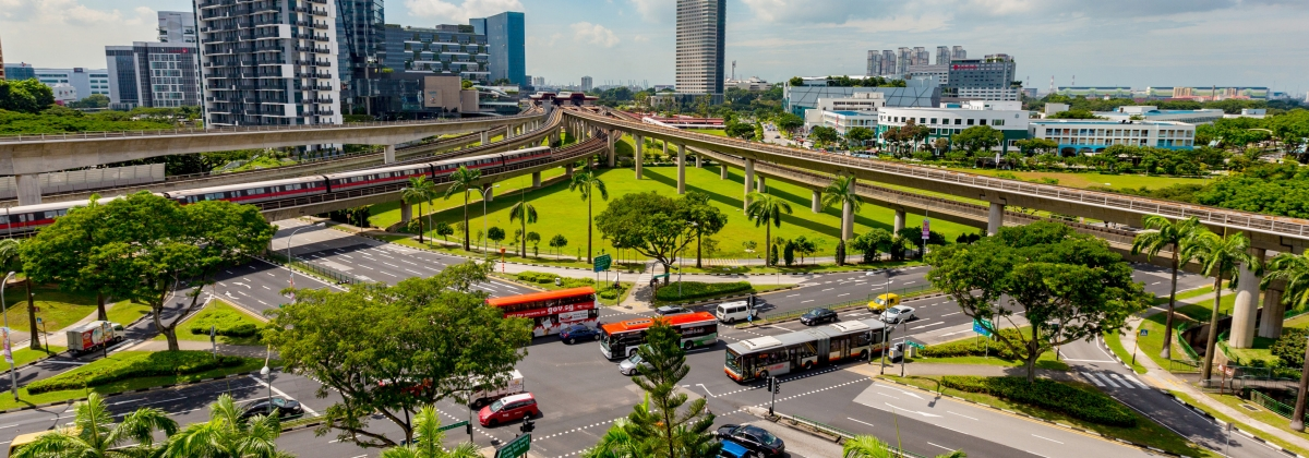 This is an image of land transport in Singapore featuring trains, bus and roads